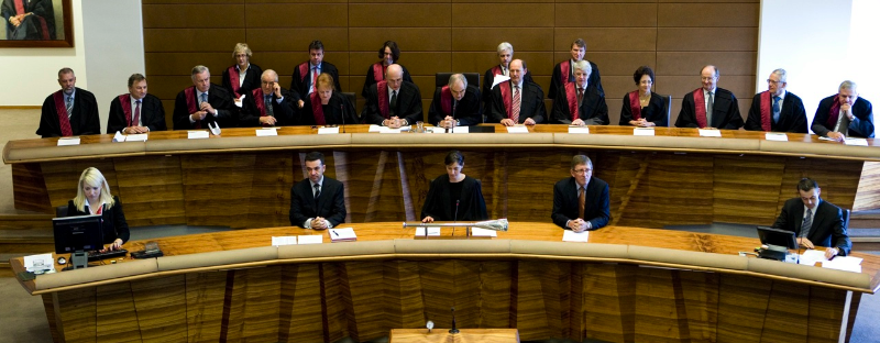 Justices sit elevated on bench