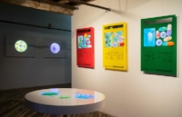 Installation view at artist's studio loft. Photo: Andrew Frost   Front: Last supper? (2012), acrylic table with embedded video screen.   Right: Endangered Species, Pollinators (2014), acrylic pills, video screens embedded in colored acrylic cases.   Back: PORTALS (2014), acrylic hemispheres, video screens embedded in wooden white finished cases.