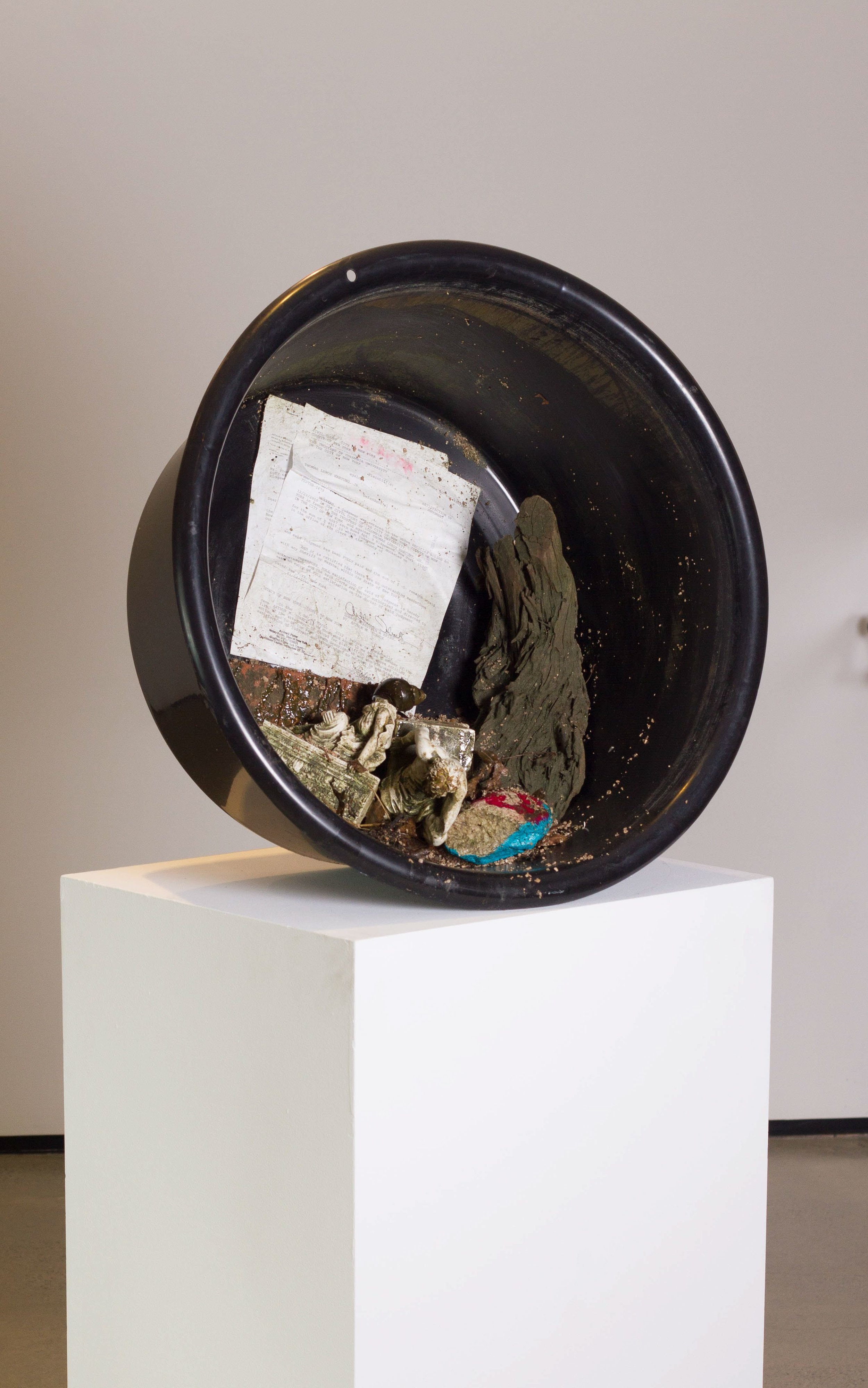 Tommy Hartung    The Trustees , 2018  Found objects, gravel, letter, rubber bucket, acrylic, varnish  25.5 x 25.125 x 12.25in. (64.8 x 63.8 x 31.1cm)