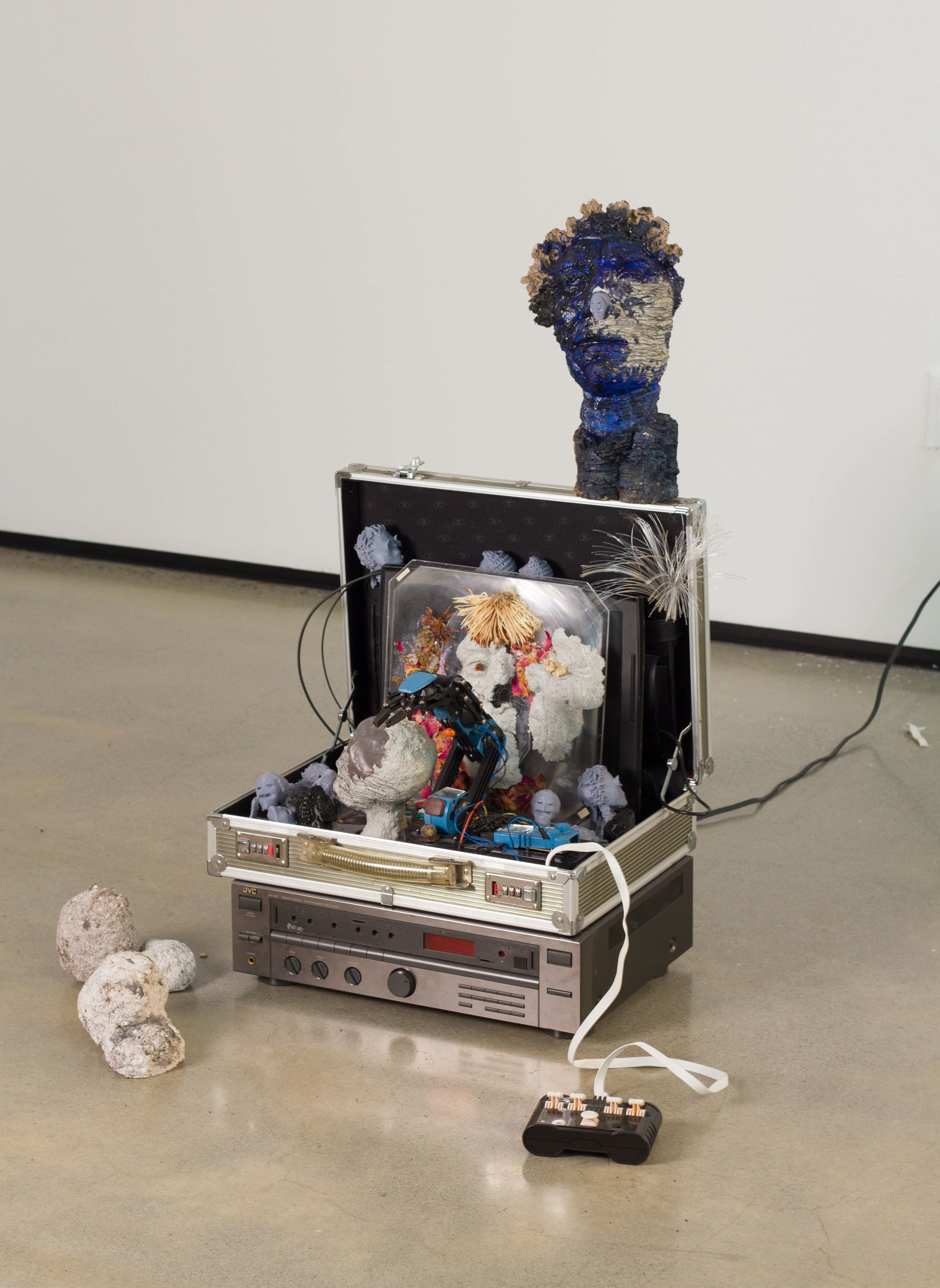 Tommy Hartung    Guidiz , 2017  3D prints, celluclay, laptop, base shaker and found objects  22 x 24.5 x 23in. (55.9 x 62.2 x 58.4cm)