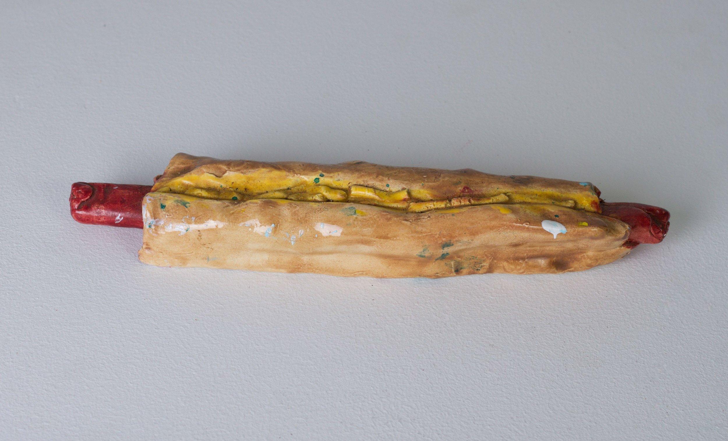Tommy Hartung    Hot Dog , 2016  Glazed ceramic  1.5 x 10.75 x 2in. (3.8 x 27.3 x 5.1cm)