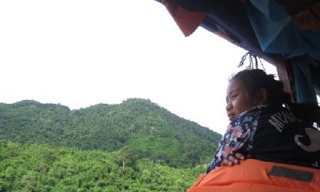 Laotian Girl Watching the Scenery Goes By