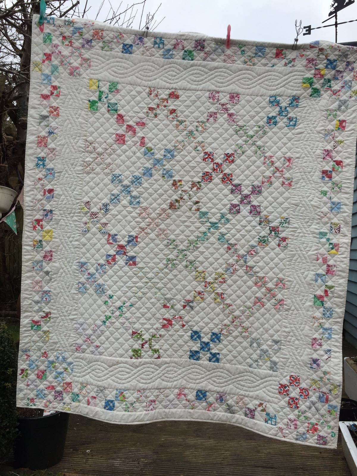 The Quilt I made in my hotel room after coming across Feed Sack fabric for the first time at a quilt show in Ascot