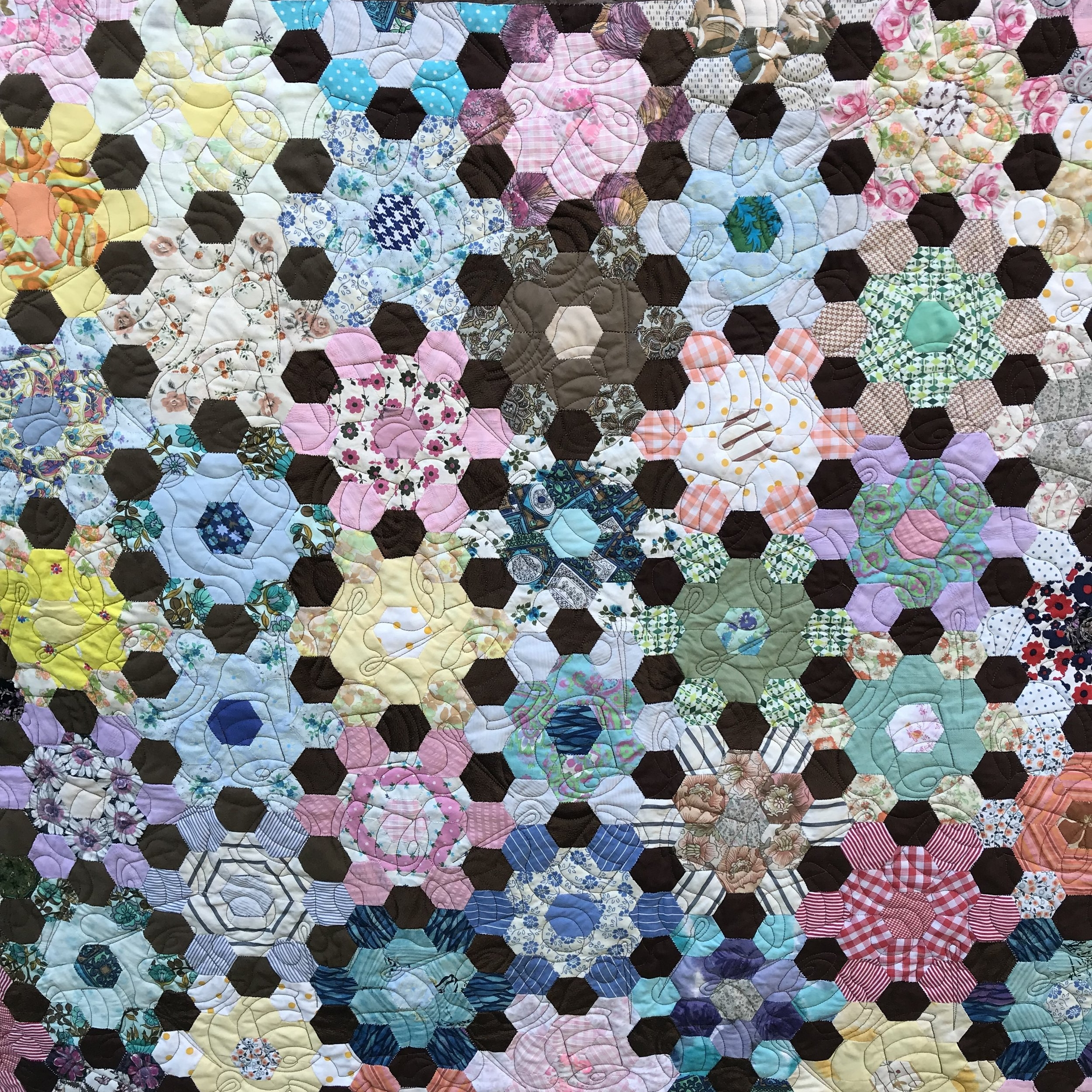 Andee's Mum's Quilt is quilted with needles and threads.