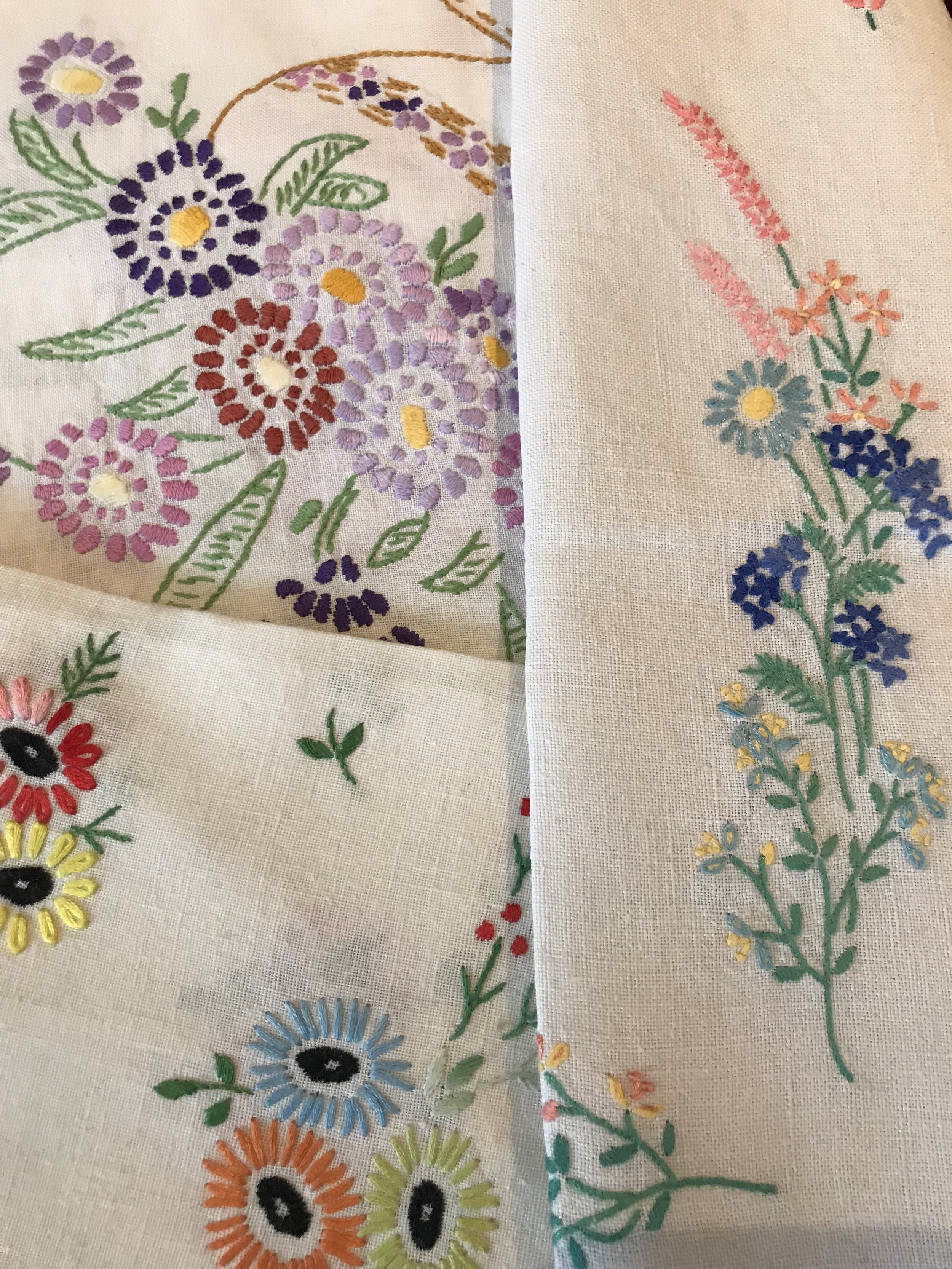 Just some of my large collection of vintage table cloths.