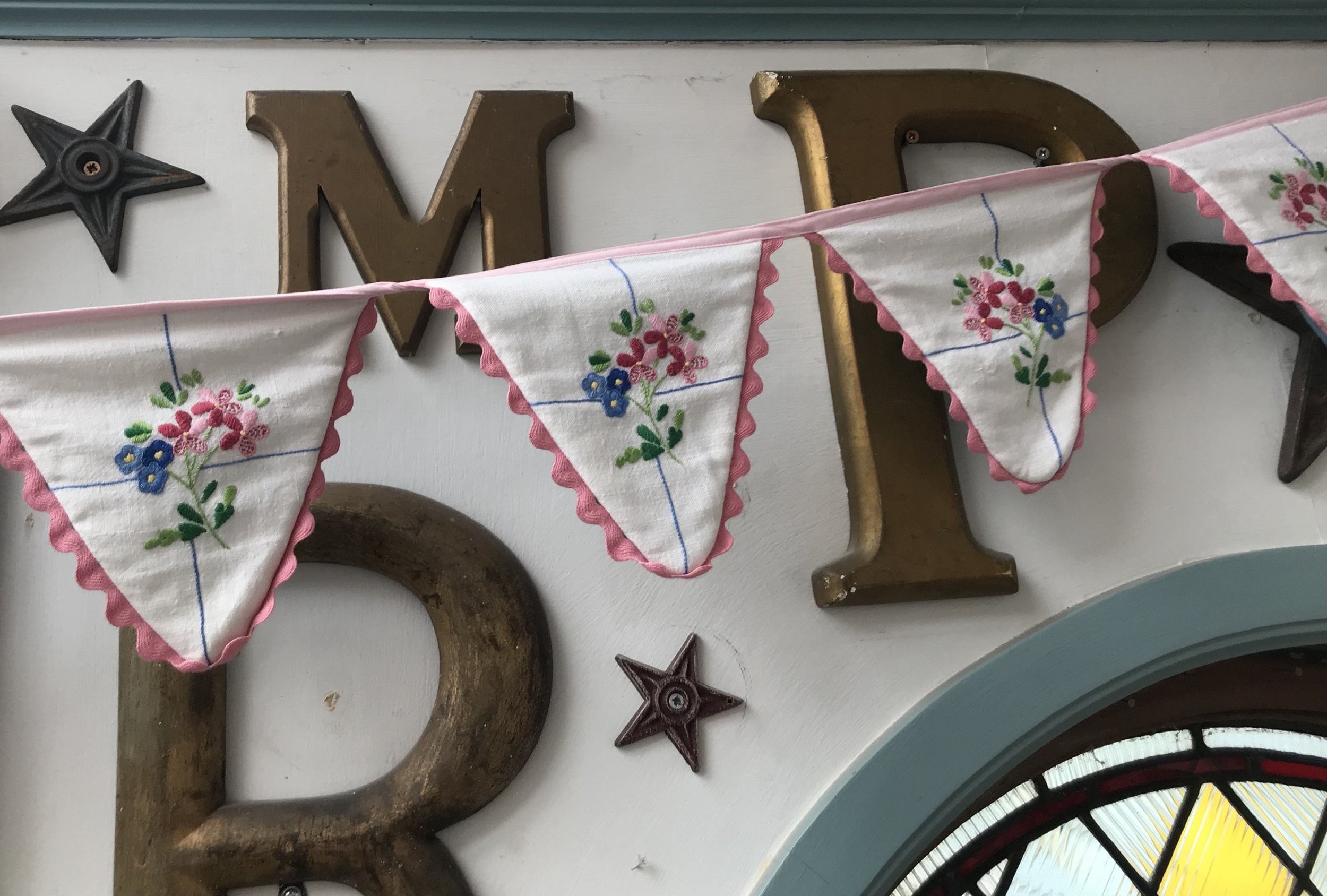 Some bunting I made from damaged vintage table cloths. There really are 100s of things you can do with them! Keep an eye out in the charity shops.