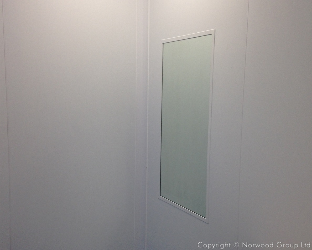 Fujifilm Flush mirror integrated within the white steel wall partition