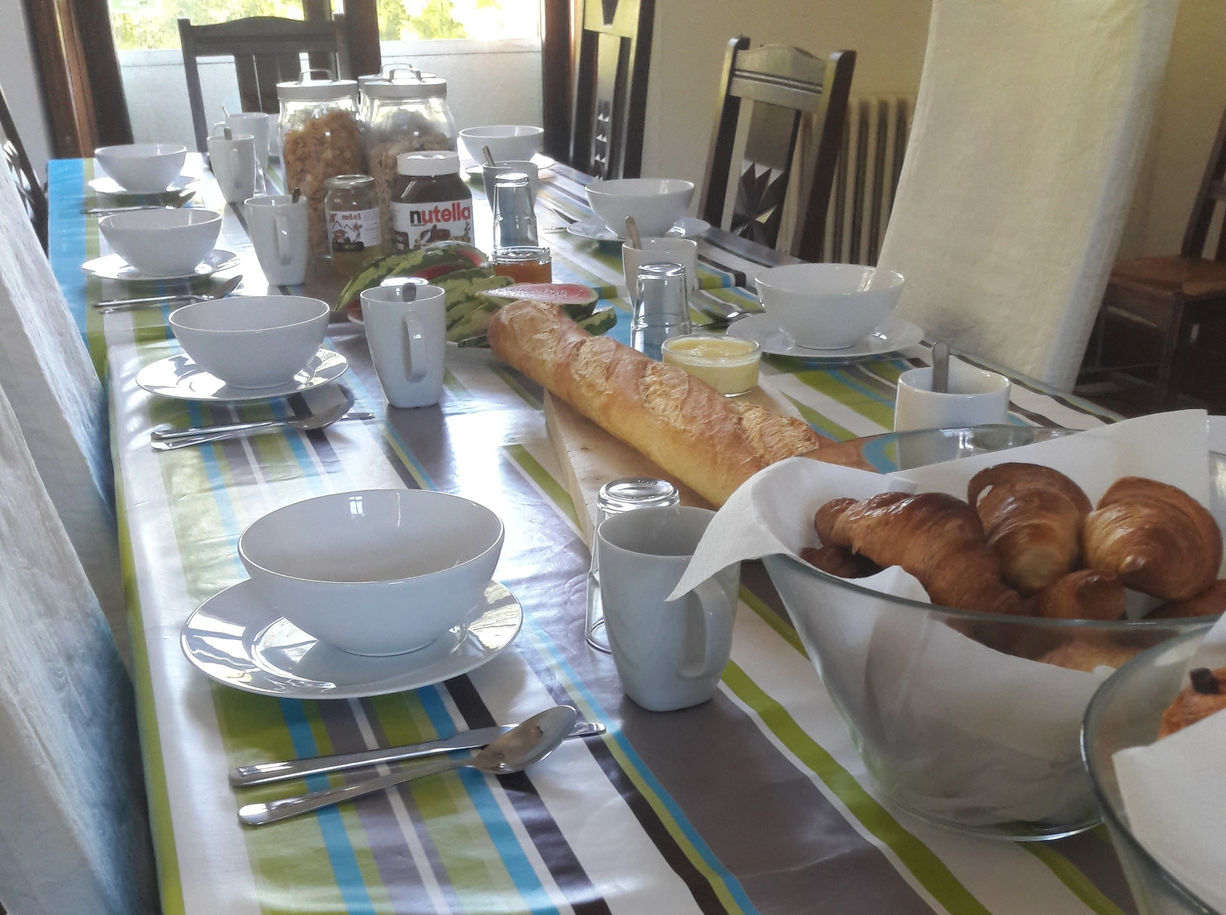 The heart of the home - Our dining table packed with breakfast goodies