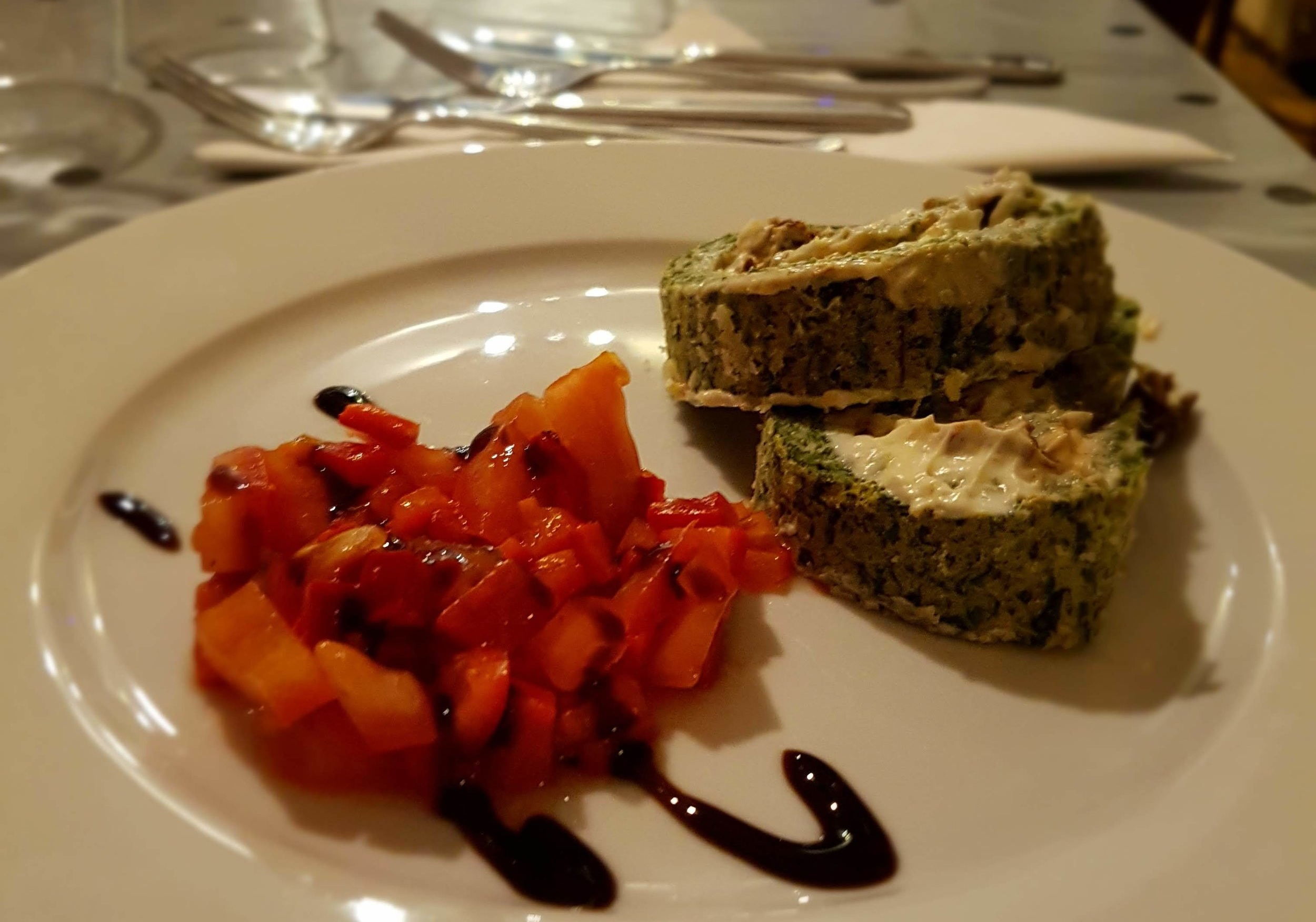 Spinach and sun dried tomato roulade - served with a salsa of tomato and roasted red pepper