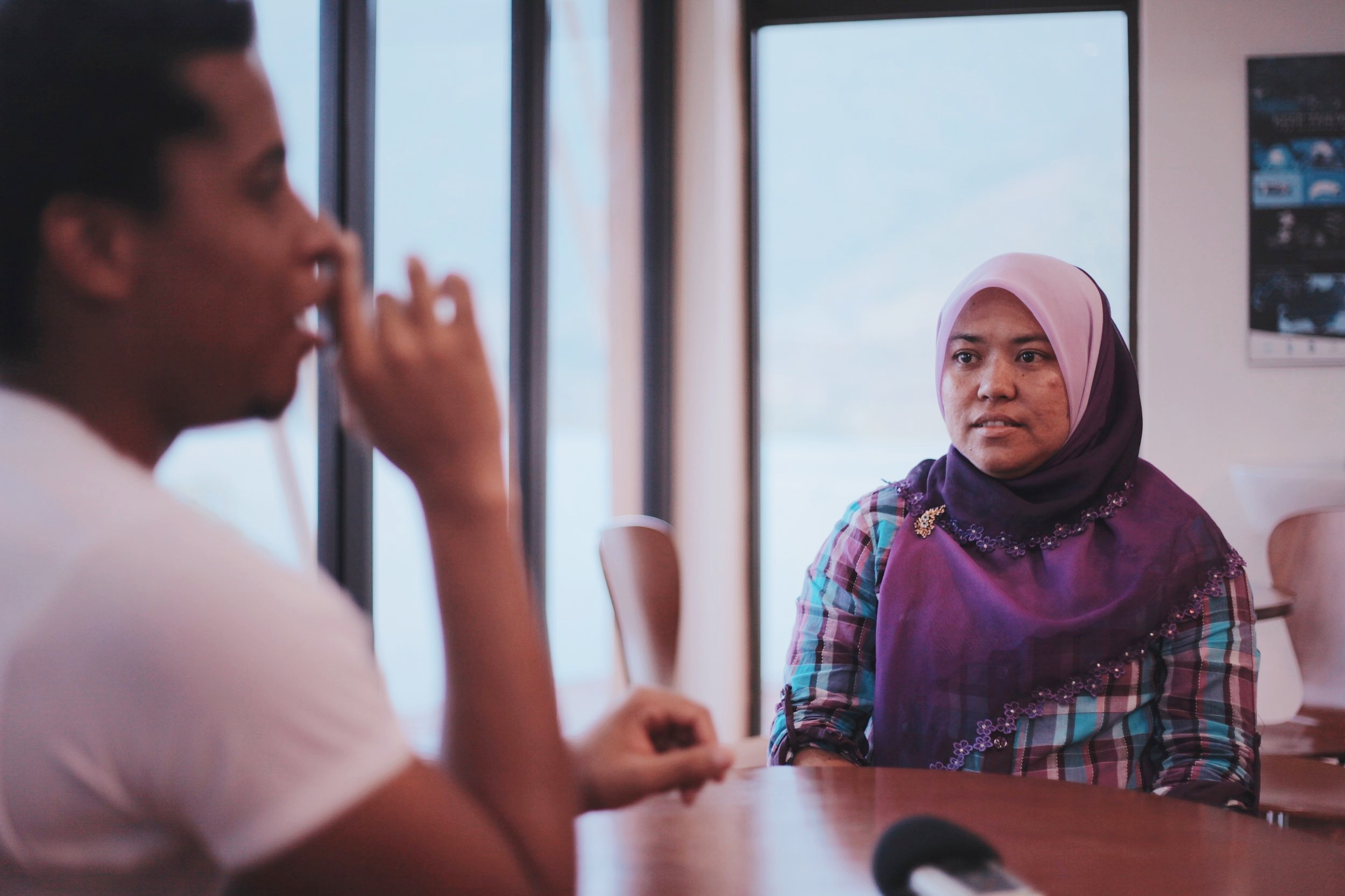 Kak Ros listens attentively to Gerald's questions