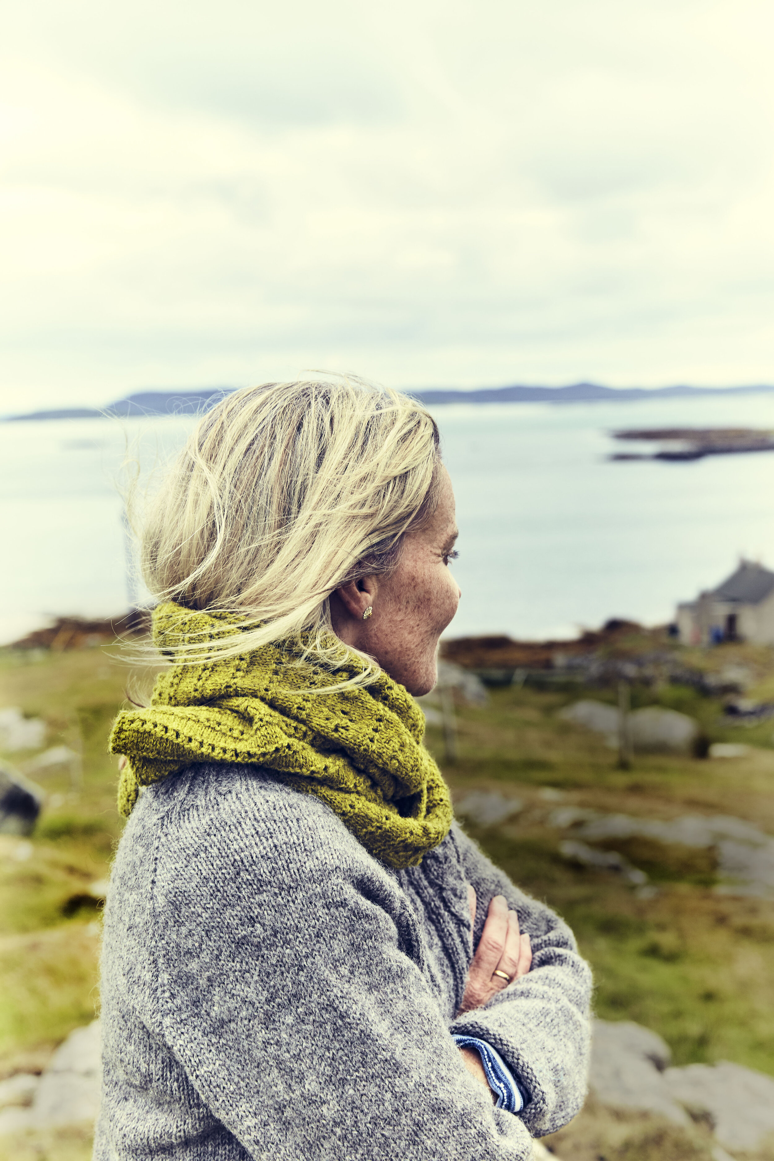 This is me on Sunhill Croft, Isle of Berneray, Outer Hebrides.  Machair Wildflower Shawl  in  Corn Marigold yarn.