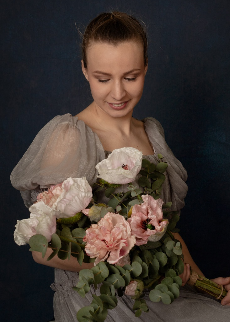 The young girl with the bouquet