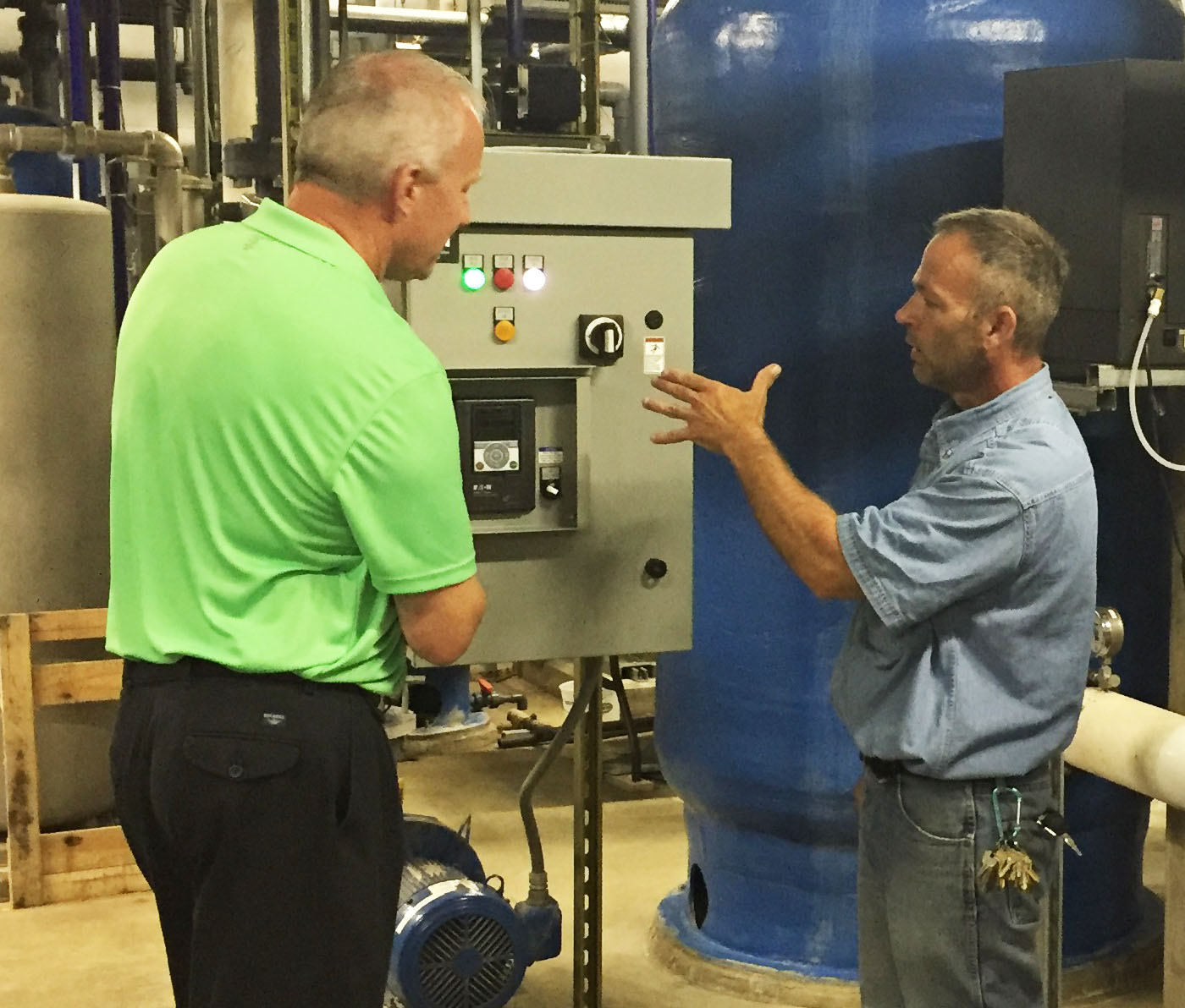 Doug Manders, Account Manager, discussing the Eaton VFD with Facilities Manager John Oglesby.