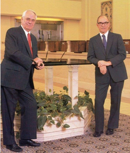 """These are a couple of pictures that I treasure that bring back fond memories of our earlier years at Heartland. One is a picture of Jim and my father, Lynn S. """"Bill"""" Fuller, in DB&T's main bank lobby on 14th& Central in Dubuque, Iowa."""