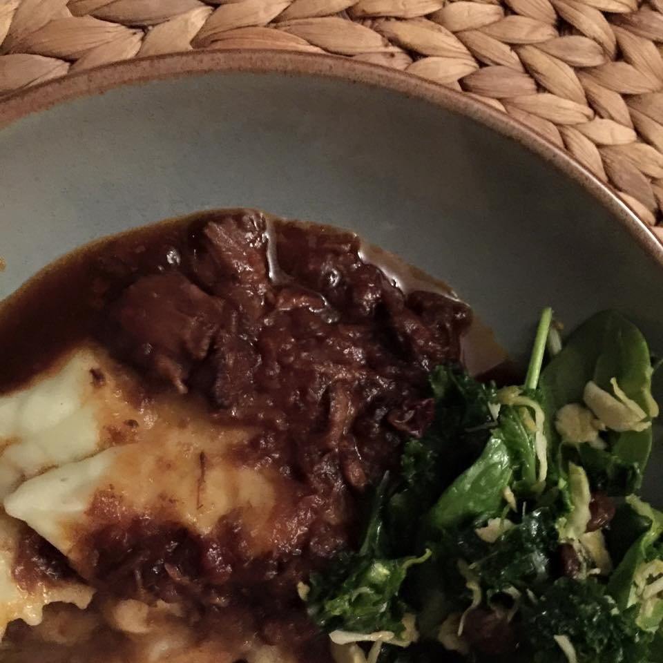 Oxtail stew with star anise and cinnamon; celery mash; salt-massaged kale, Brussels sprout and cherry salad. Image by Susan Batchelor