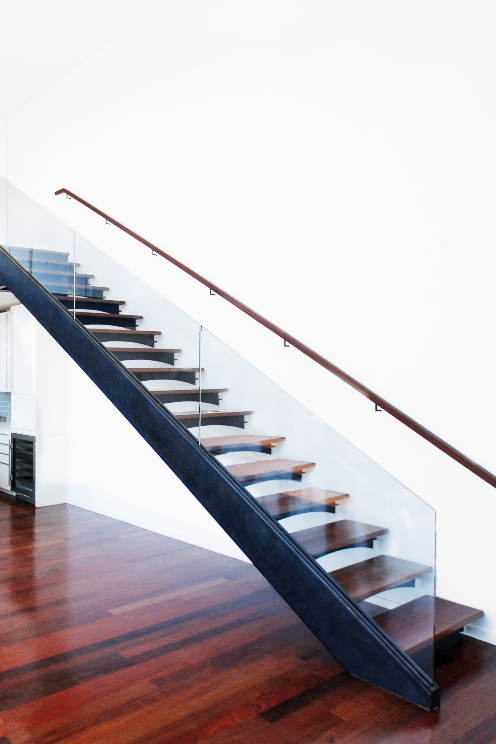Floating Staircase With Custom Bent Glass