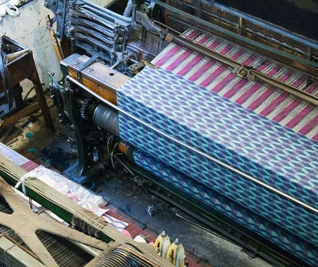 This is how my blankets are made! On a large traditional Dobcross loom in rural Wales. I love using old techniques to create modern designs - tying in with the history of British weaving, in an up to date way. ⠀ #madeinwales #choosewool #welshblanket #welshmill #weaversofinstagram