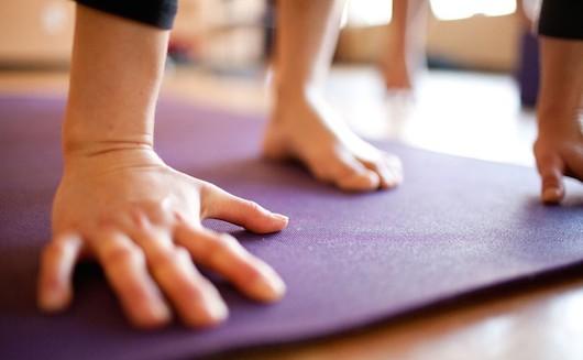 yoga-hands-mat.jpg