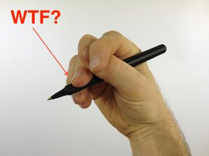 holding a pen wrong like a serial killer