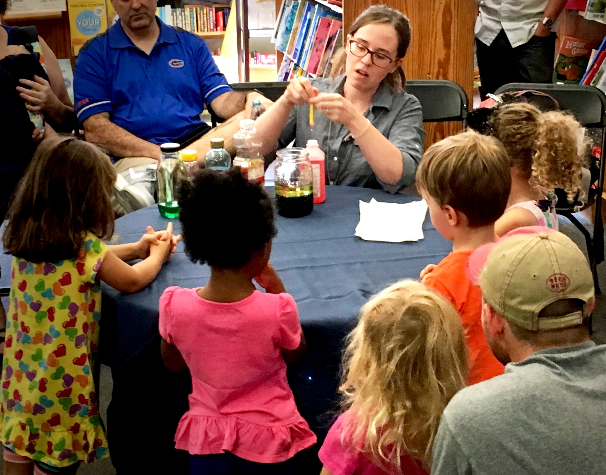 Making a rainbow in a jar - small group science experiment.