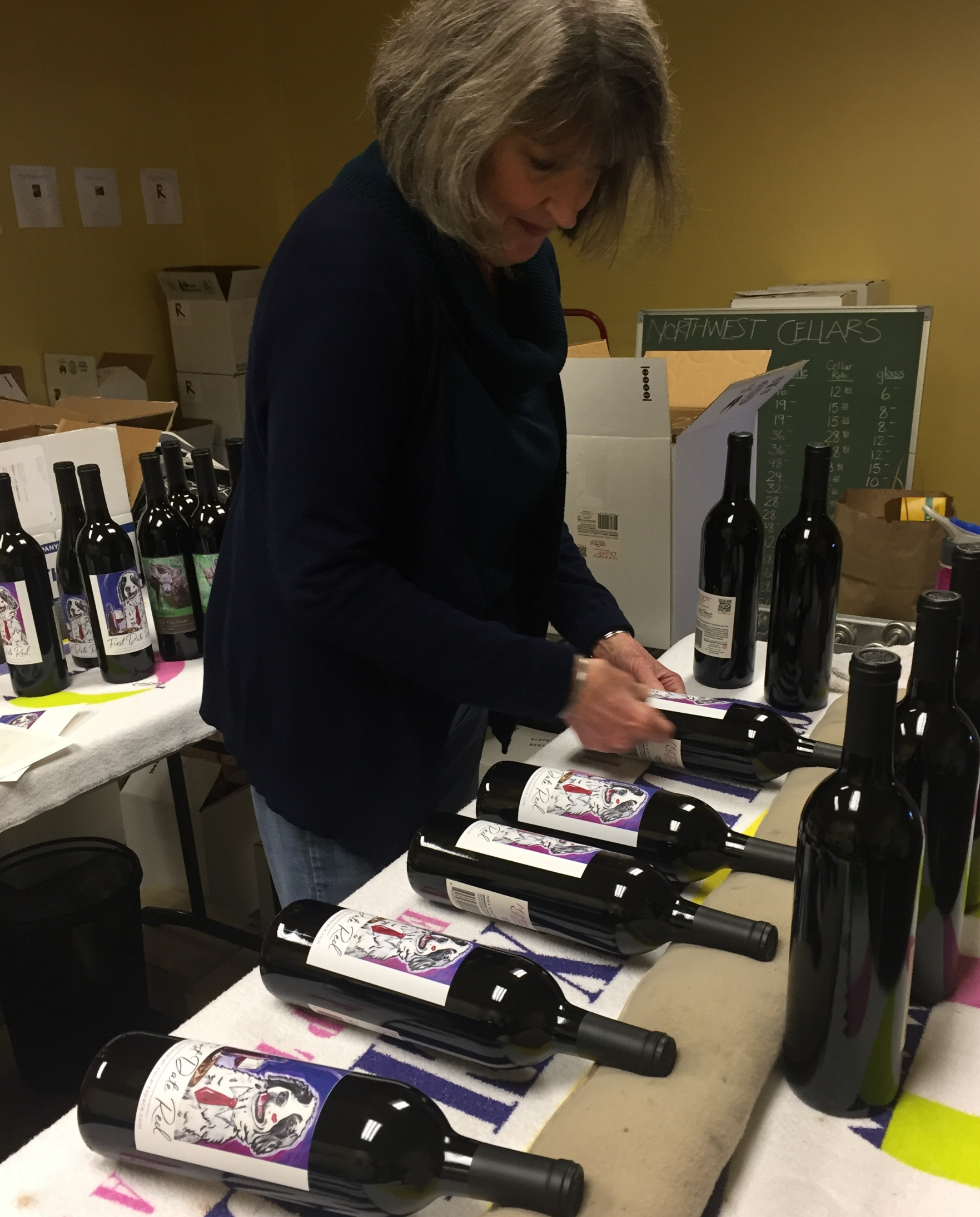 """First Date Red"" Labels being put on bottles at a recent event to honor volunteers for Homeward Pet."