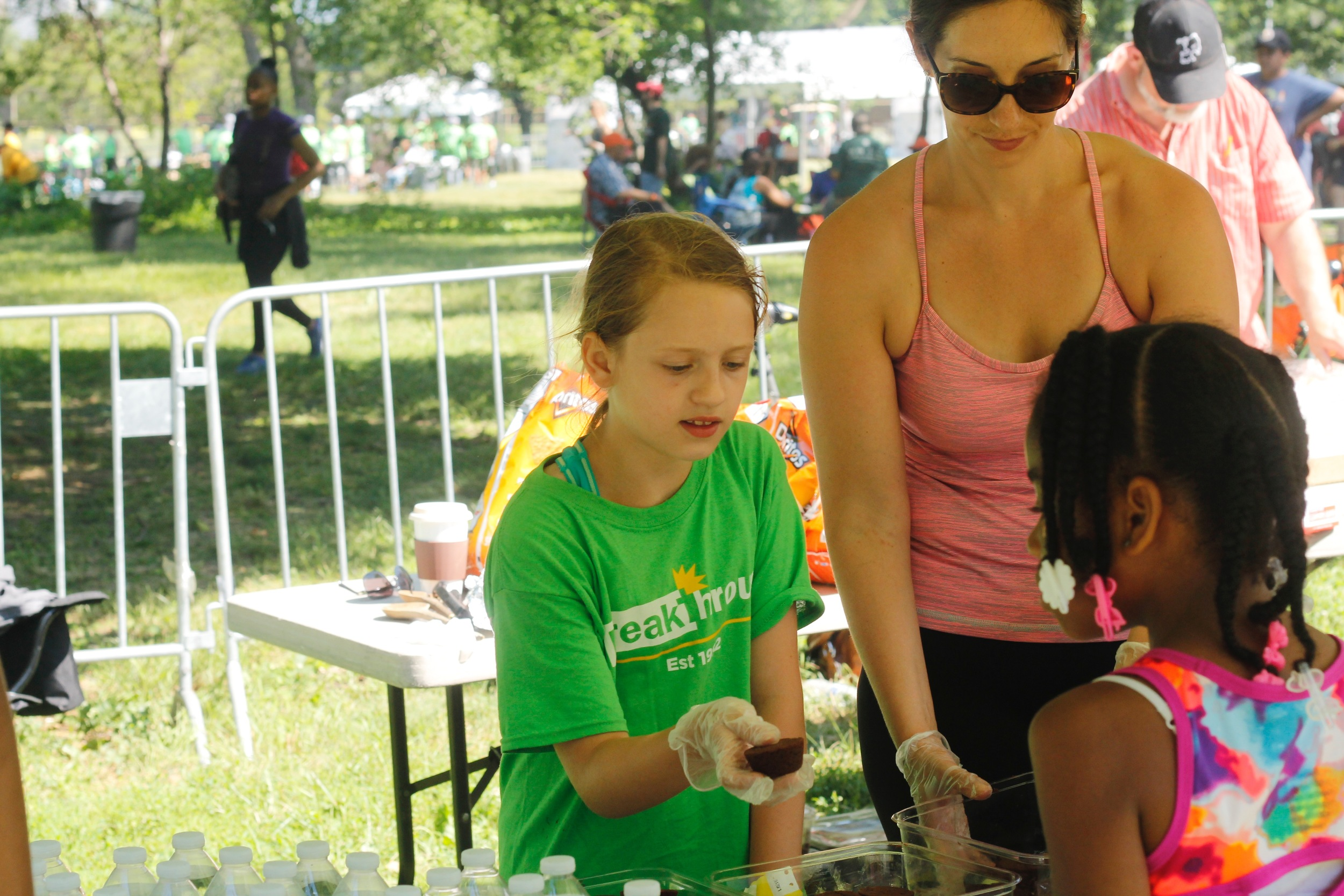 Serving hotdogs, chips, and brownies at the Hunger Walk last Saturday