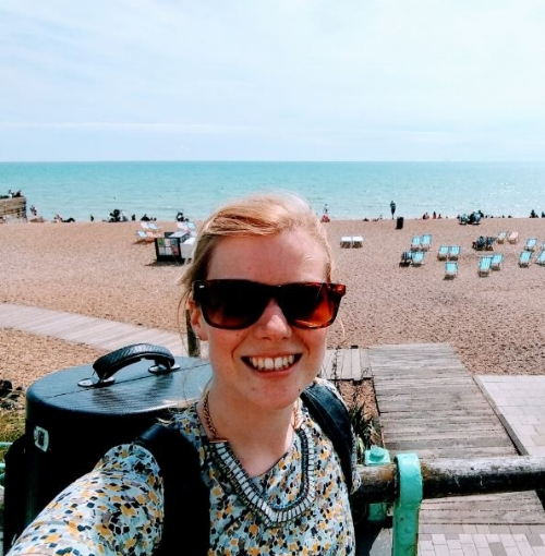 Enjoying some time on Brighton beach before heading back to London