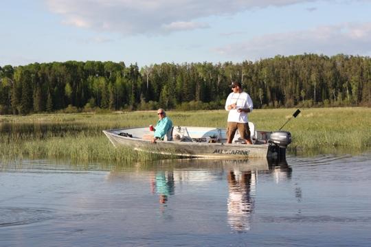 Tom Howe boat fishing the river