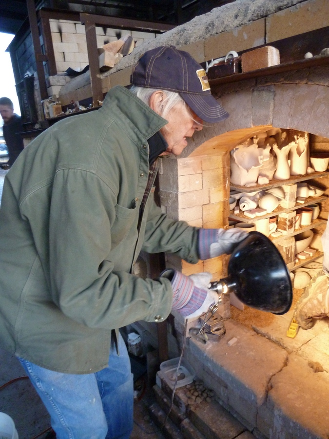 Don checking the stacking of the ware