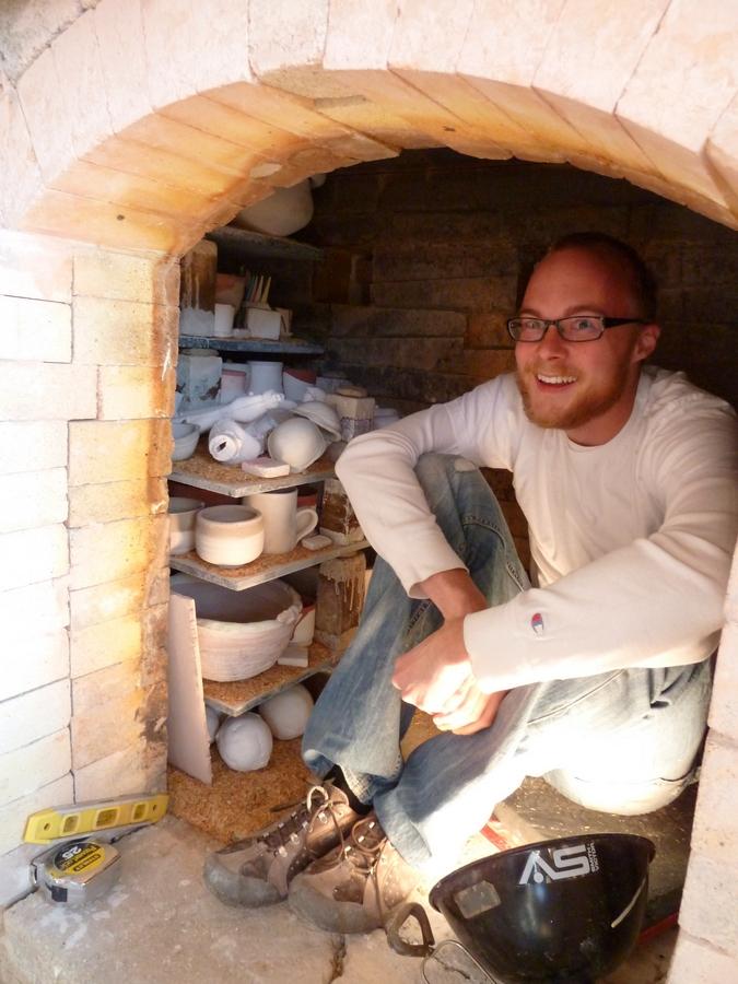 Corey loading the kiln