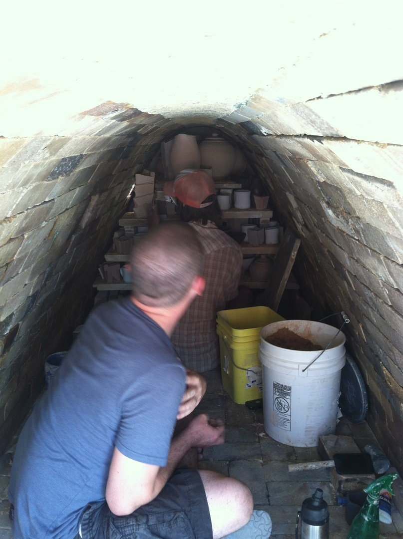 Tom and Jonathan loading the kiln