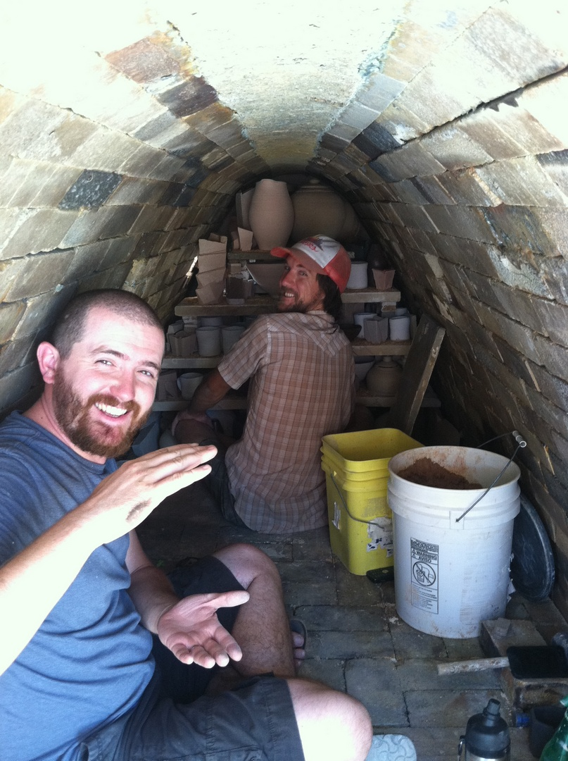 Jonathan and Tom loading the kiln