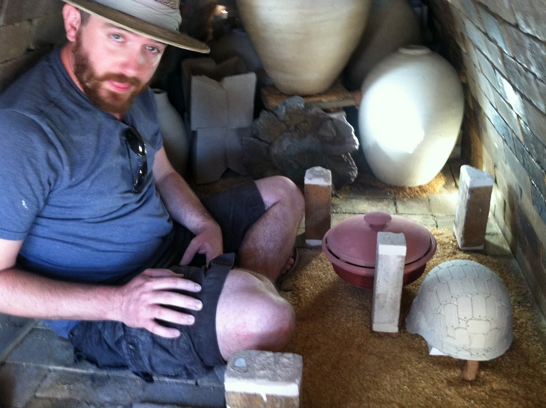 Jonathan Loading the kiln
