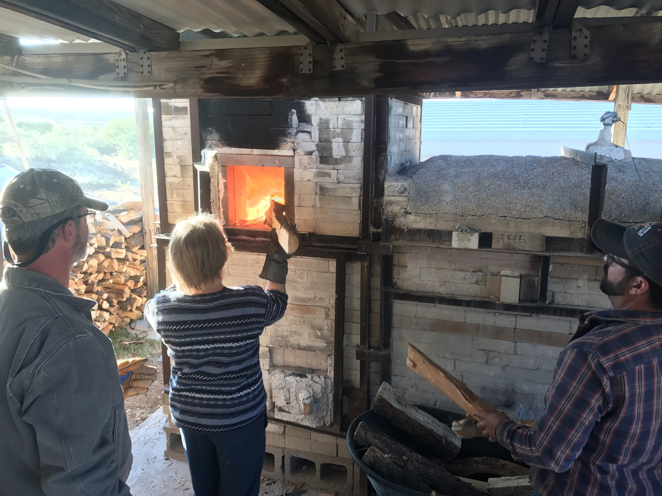 Sheryl stoking the kiln