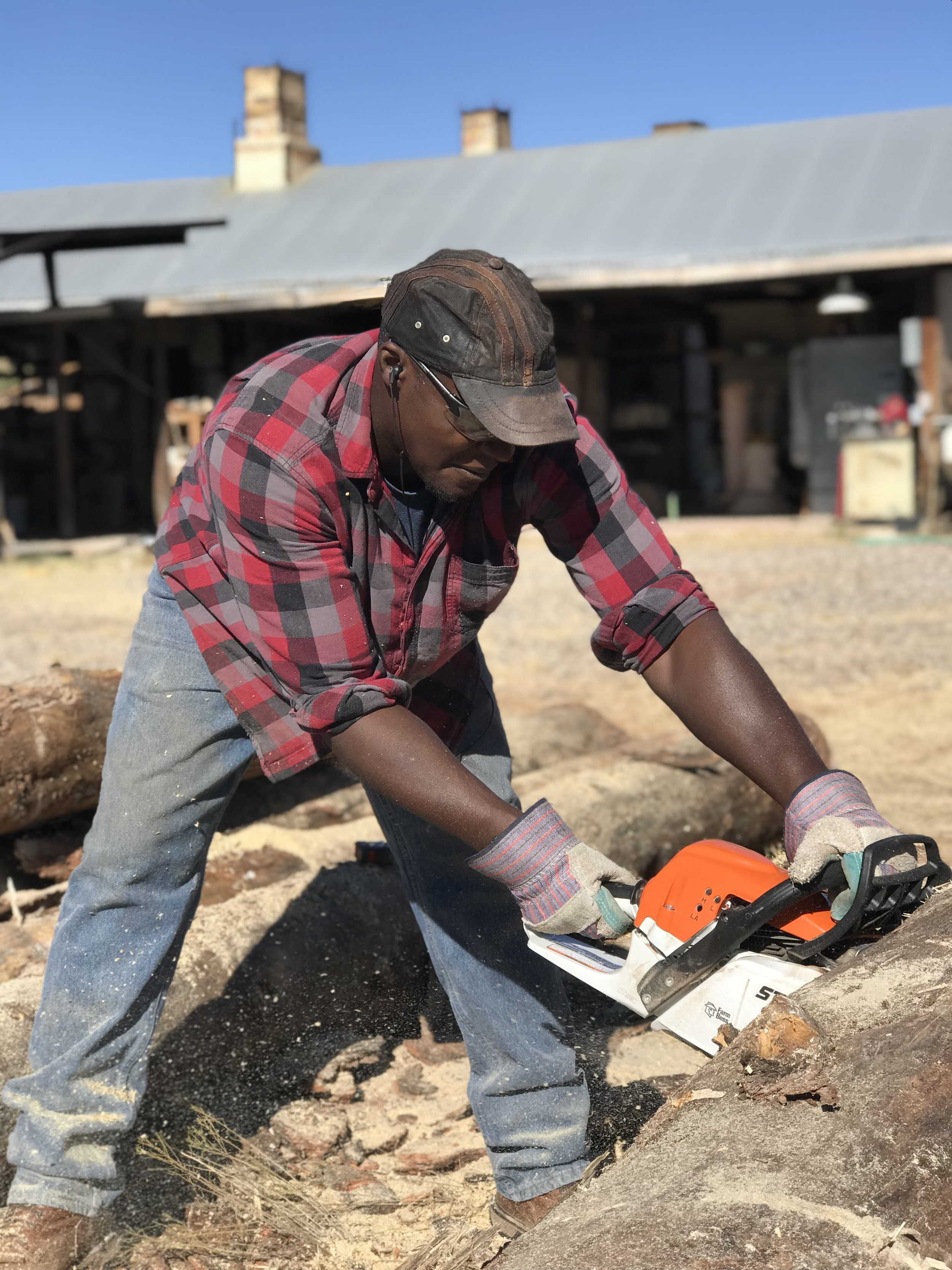 Dexter Woods sawing the logs