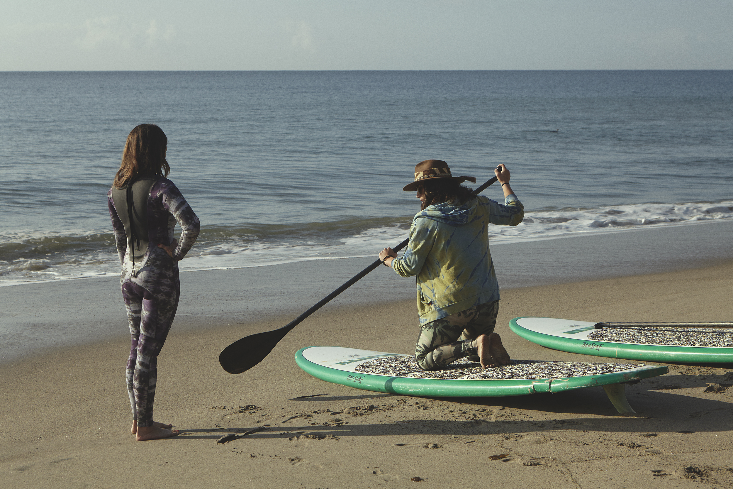 Jobi prepping Lisa for her Paddleboard Meditation