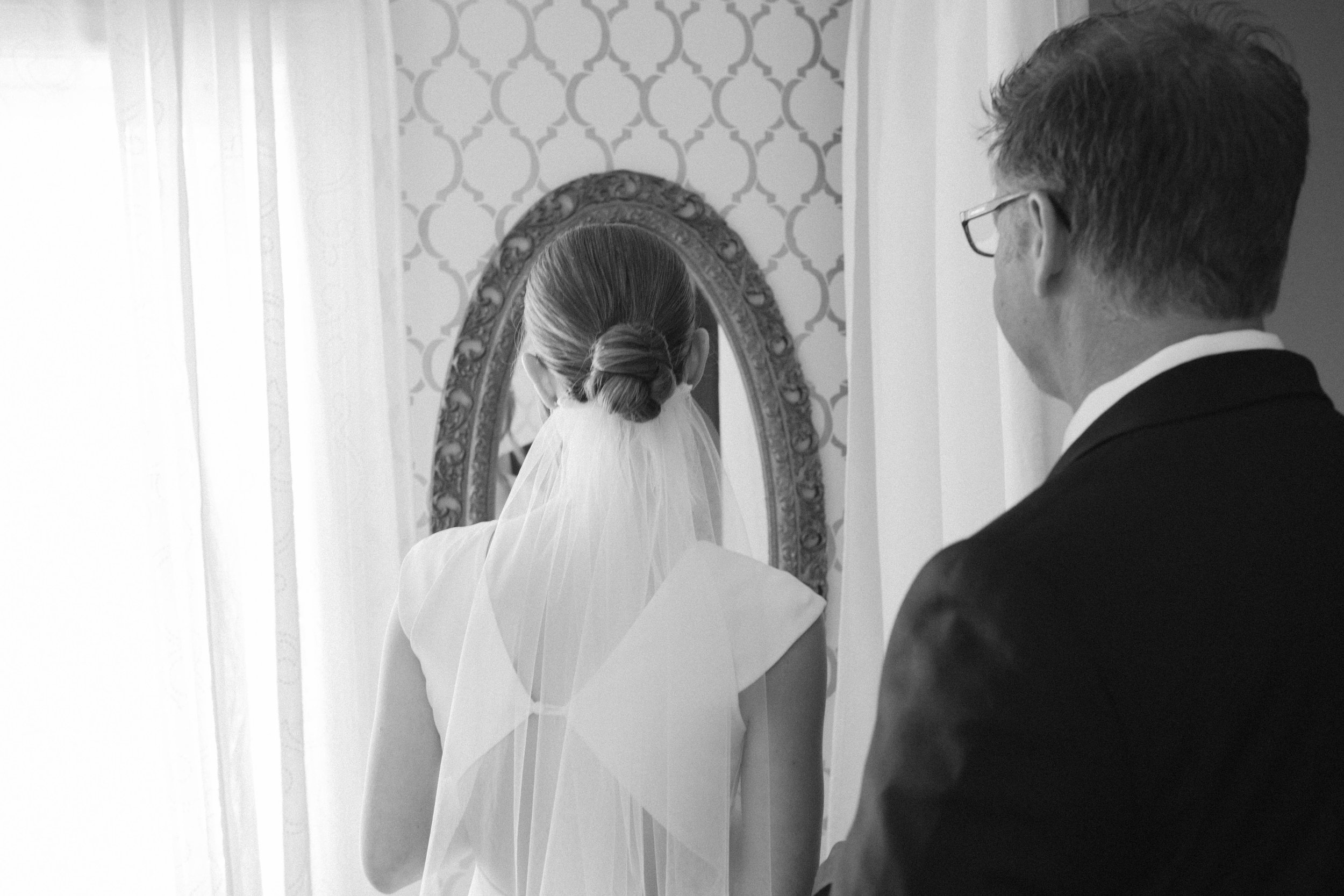 first look with dad on her wedding day