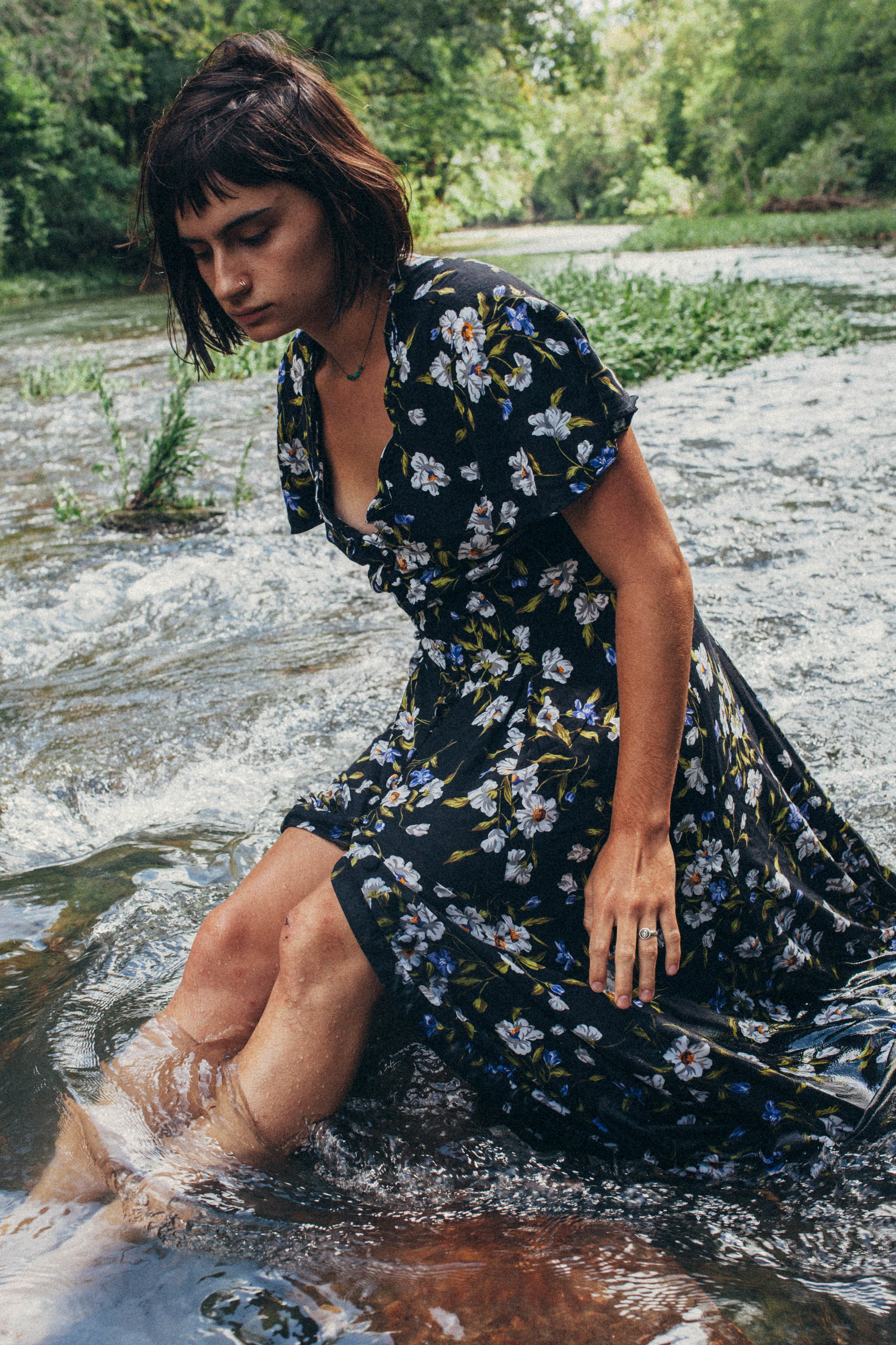 Missouri editorial session. portrait of a dark haired girl in a flowy dress in the river in