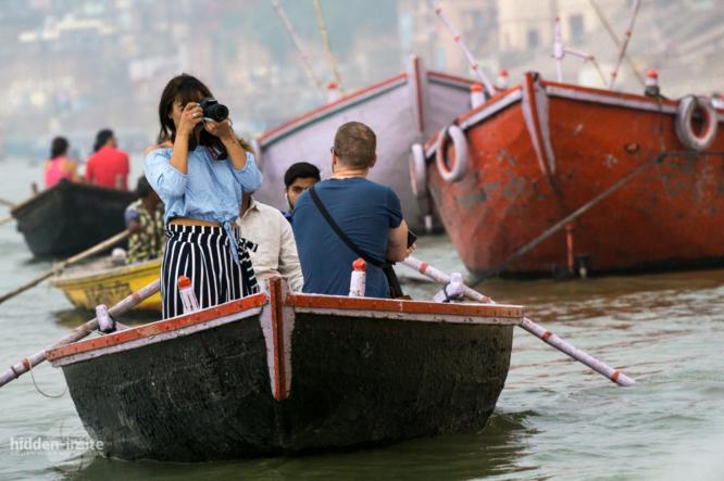 Tourist-taking-photo-from-boat-in-Varanasi-666x443_c.jpg