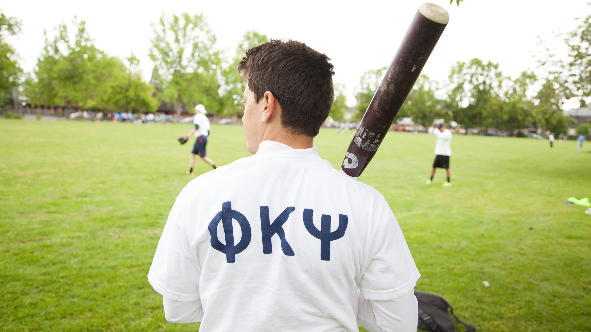 Brother Orona warms up for a game of softball during a fall recruitment event.