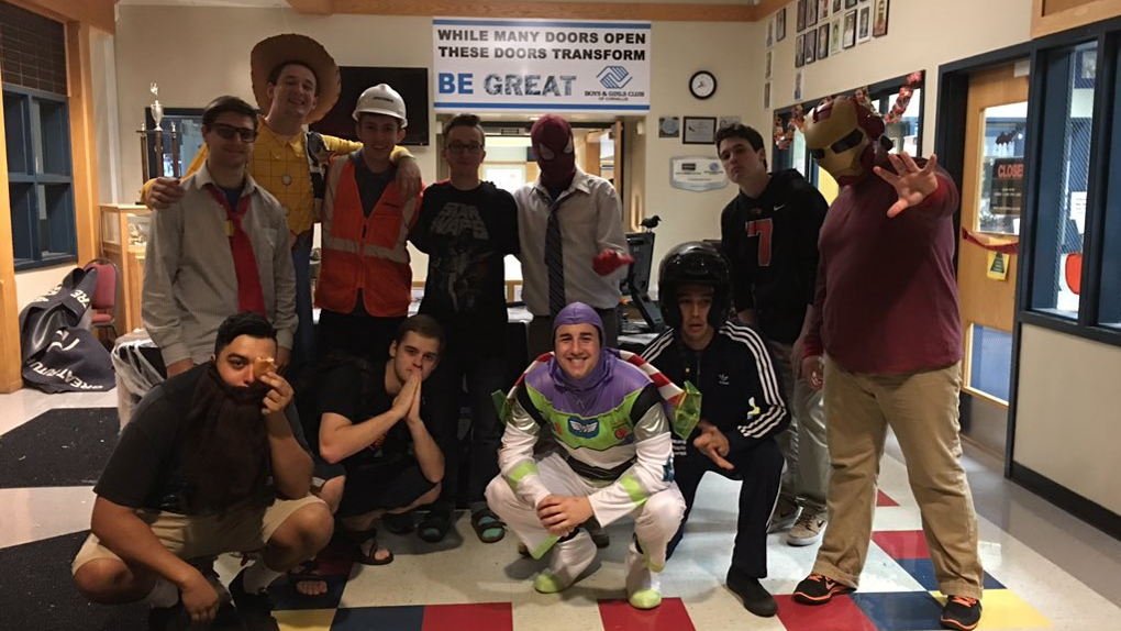 Brothers volunteering at the Boys and Girls Club's Halloween Carnival.