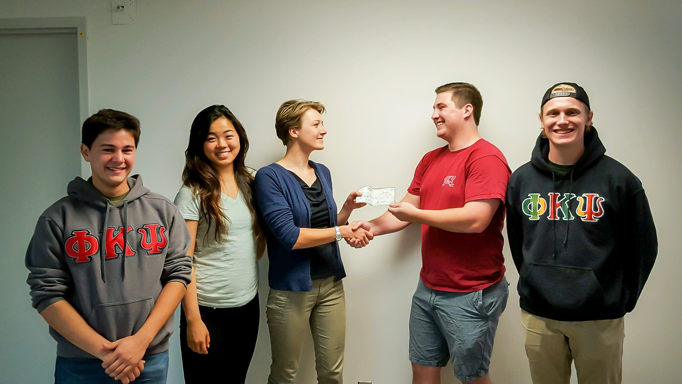 From left to right, Brothers Curtis Orona,Carter Frantz-Geddes, and Kurt Reinschmidt deliver our first donation check to the HSRC.