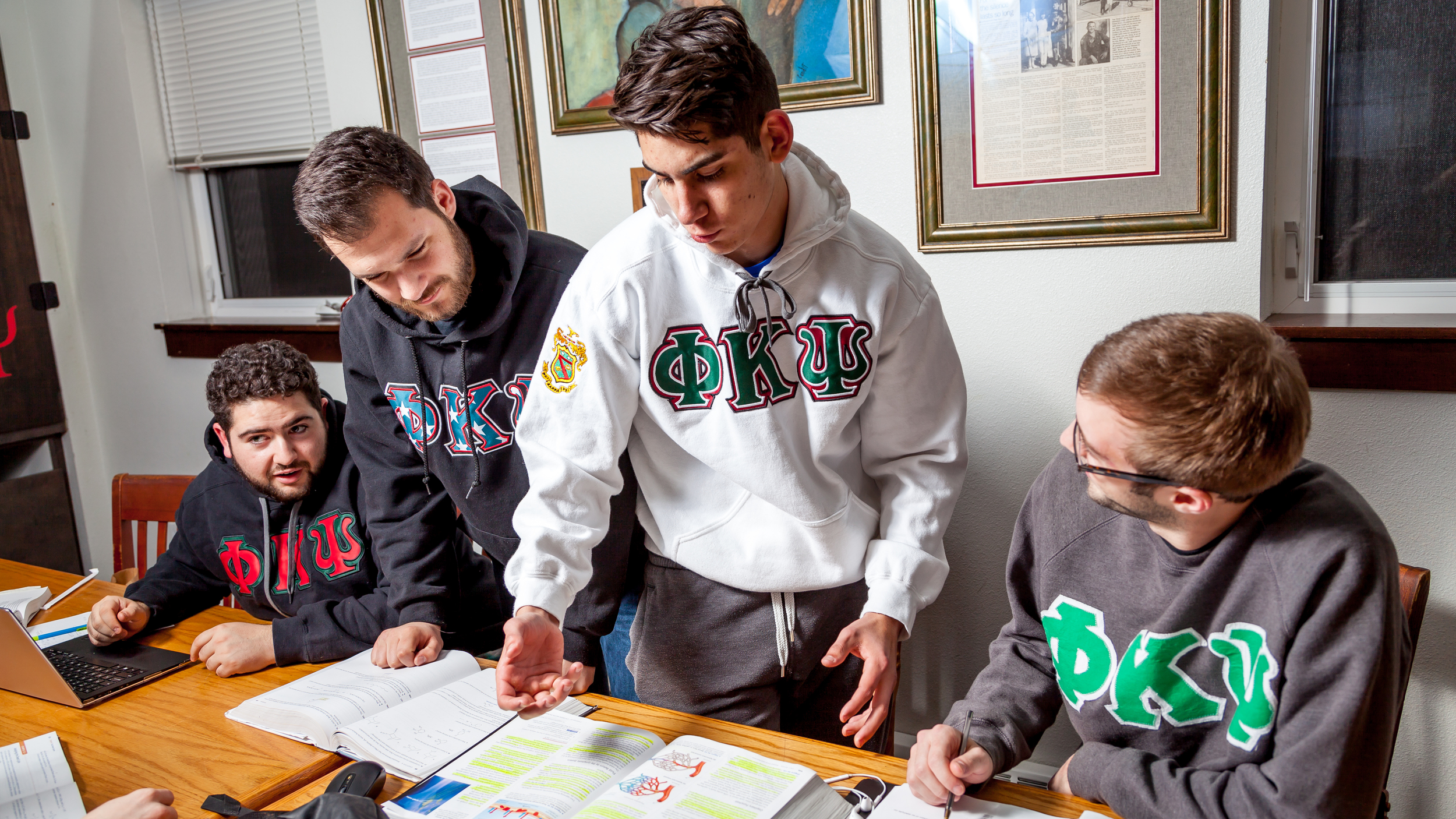 Scholarship Chairman Chano Dominguez helps his peers understand the lymphatic system during a Biology study session.