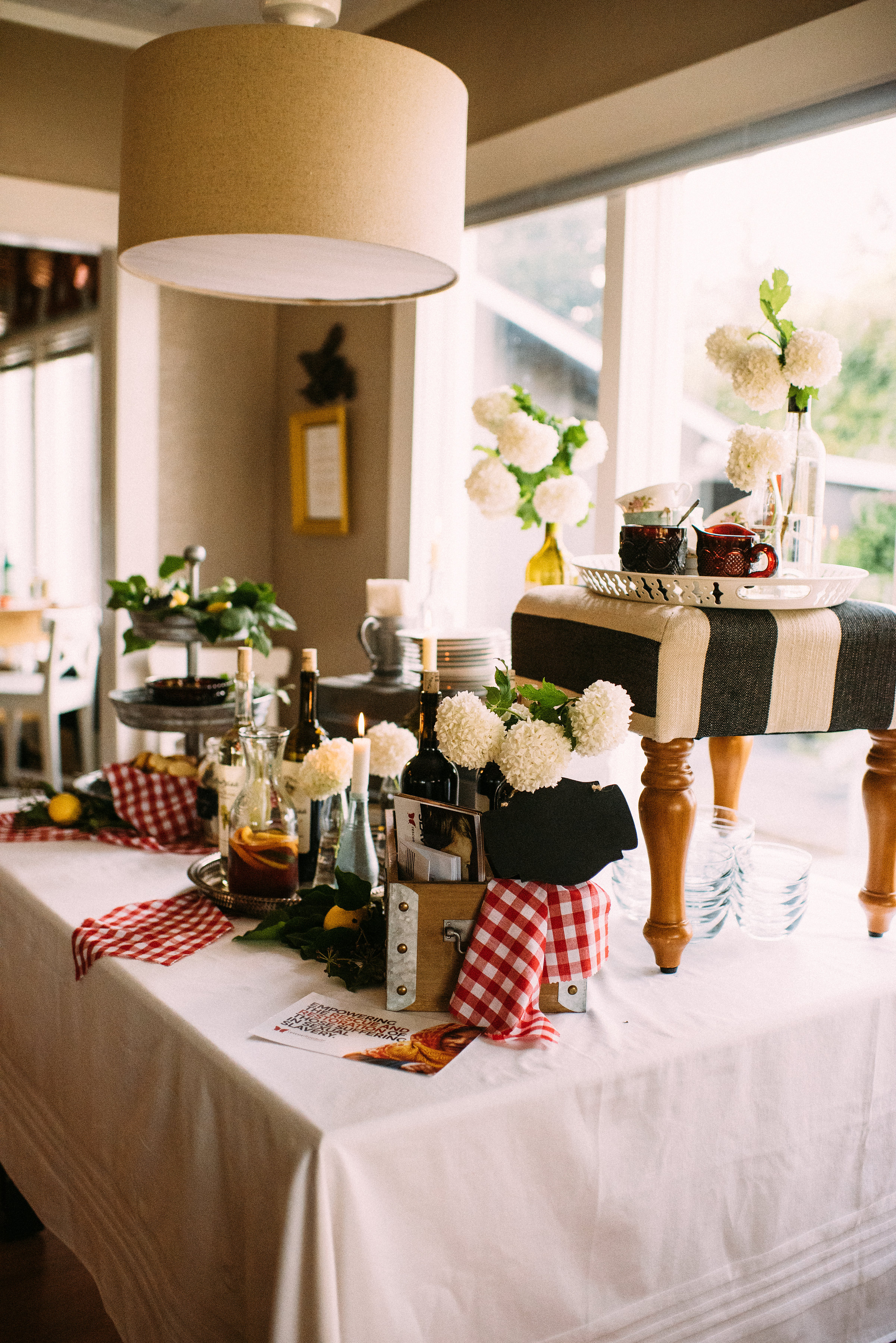 I love having a simple side table set up with drink and appetizers. I tell our guests to find their seat at the table, grab their glass and help themselves. Having a side table encourages the guests to mingle!