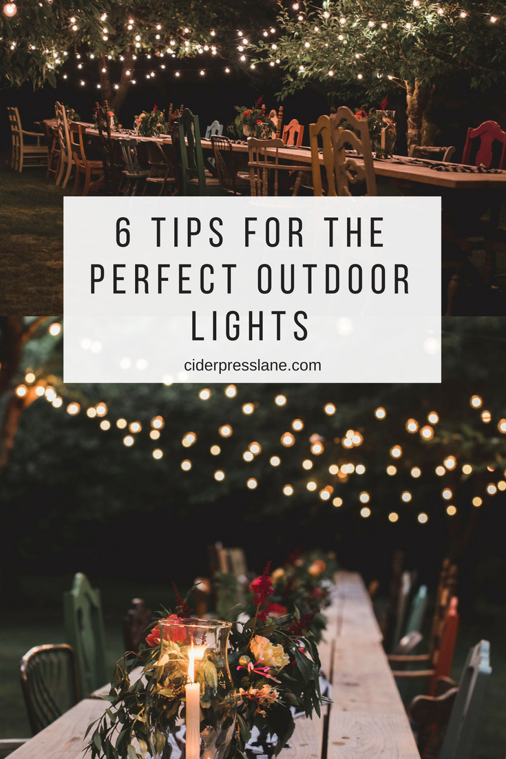 6 tips for the perfect outdoor lights garden yard orchard lighting strands dinner party.png