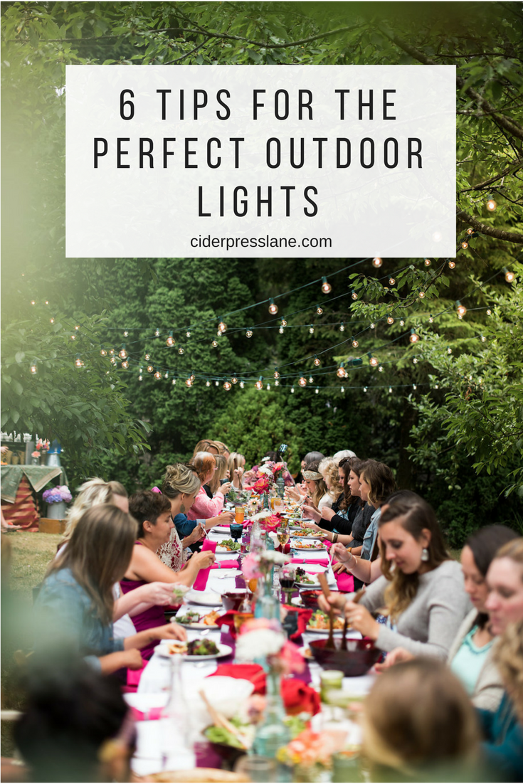 another 6 tips for the perfect outdoor lights garden yard orchard lighting strands dinner party.png