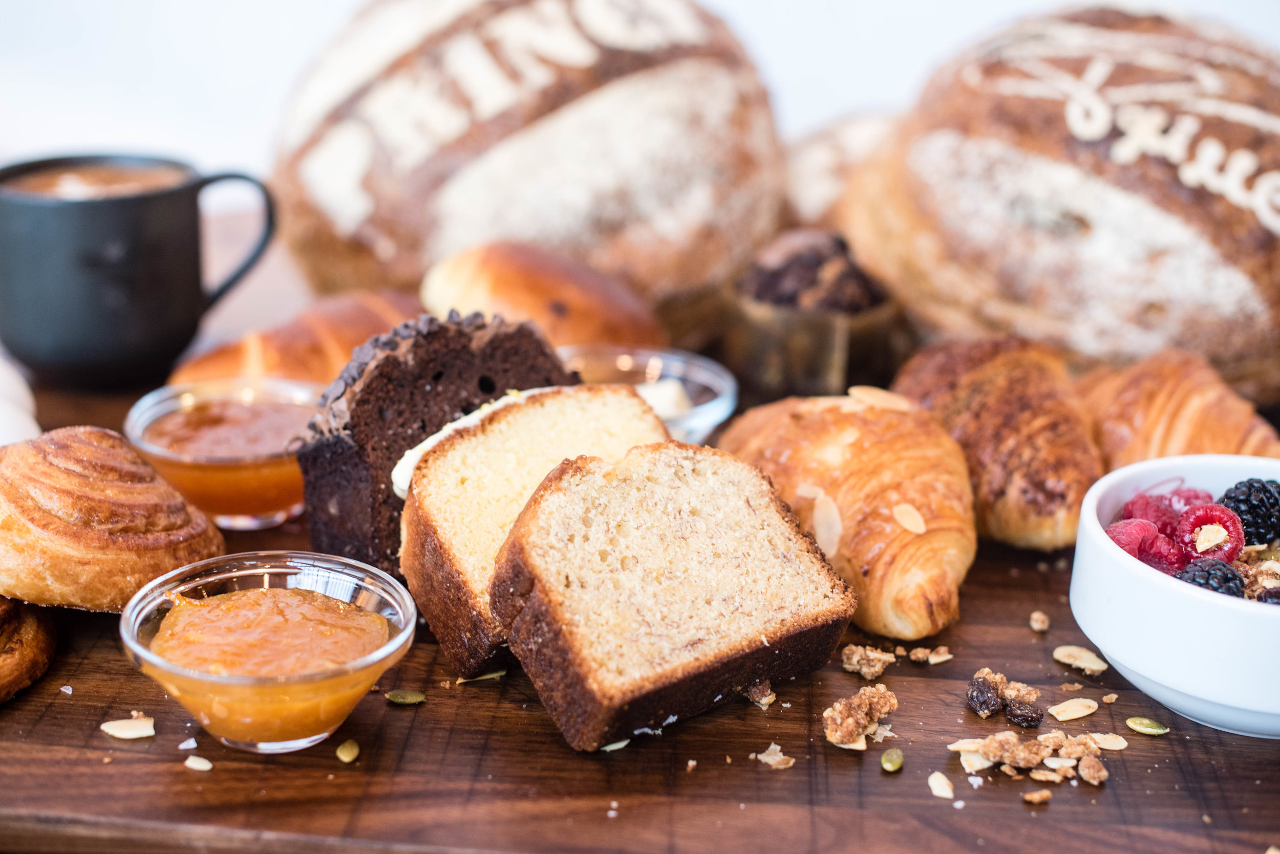 Banana Bread (front and center) surrounded by assortment of pastries