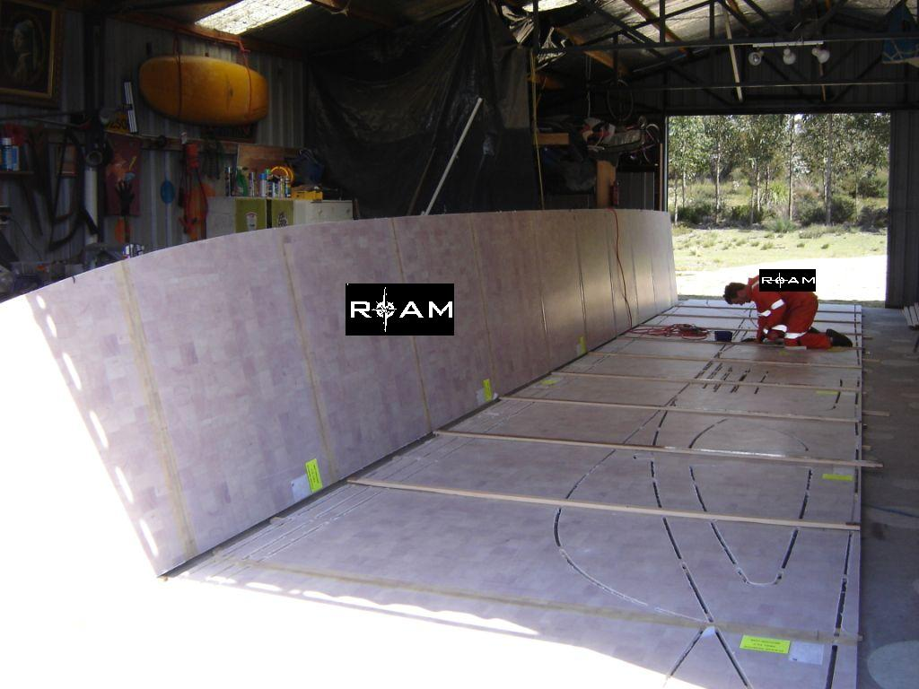 "Joining Precut Duflex panels via ""batten"" method.  Our remote location in North East Tasmania did not allow access to the ATL Z Press.  We took 3 weeks to complete joining all 178 2.4m x 1.2m panels.  November 2009."