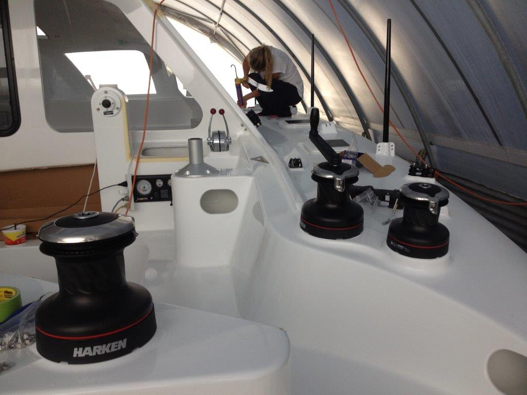 Deck hardware fit out.  Roam features primary and secondary winches on the side decks to allow for controlled and safe sail handling.   February 2015.