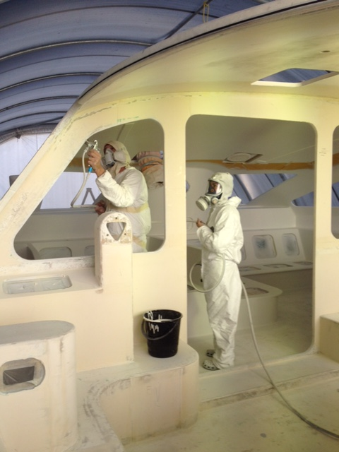 The Mirror Image crew spraying High Build Primer in the saloon of ROAM.  March 2014.